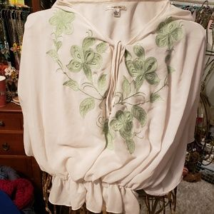 Sophie Max cream shirt with green flowers.